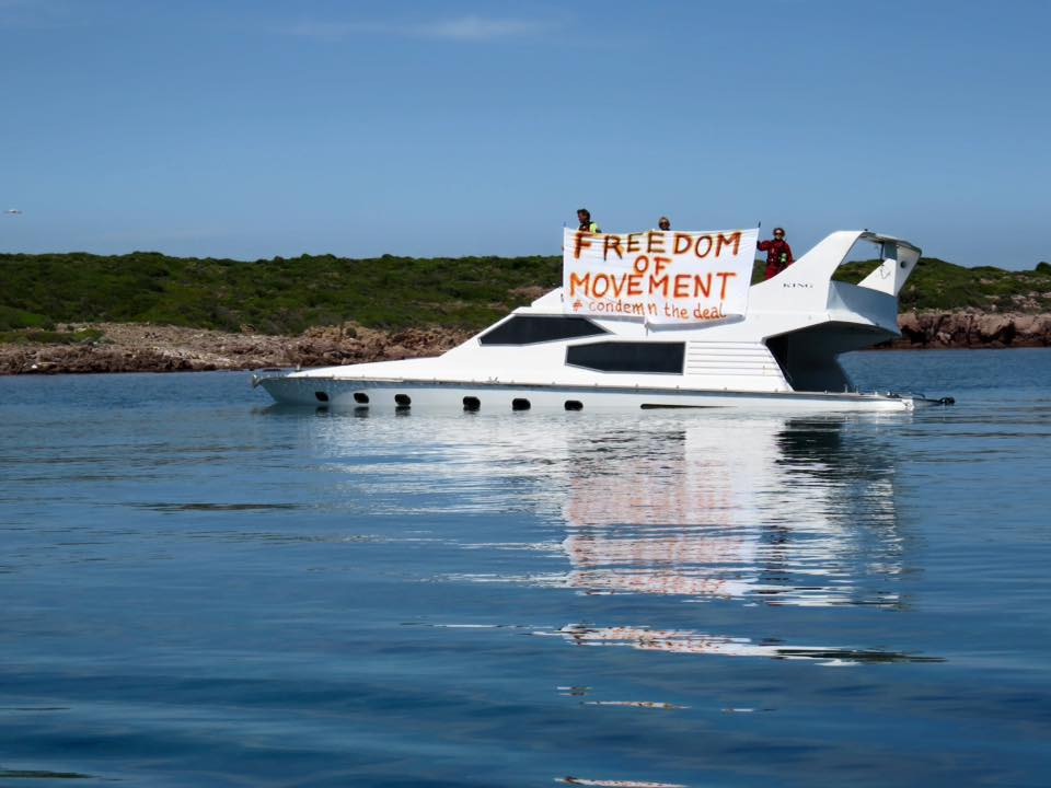 Freedom of movement banner on stranded refugee boat